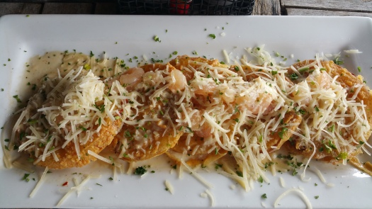 Fried green tomatoes with crab, shrimp and a remoulade sauce.